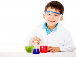 Little boy playing chemist - isolated over a white background